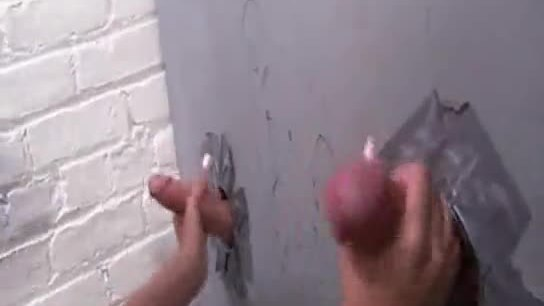 Two hard white cocks at a glory hole
