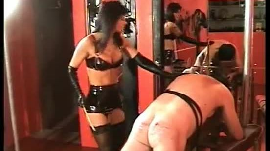 Mistress hits tied slave on the ass with a wooden stick till its bleeds